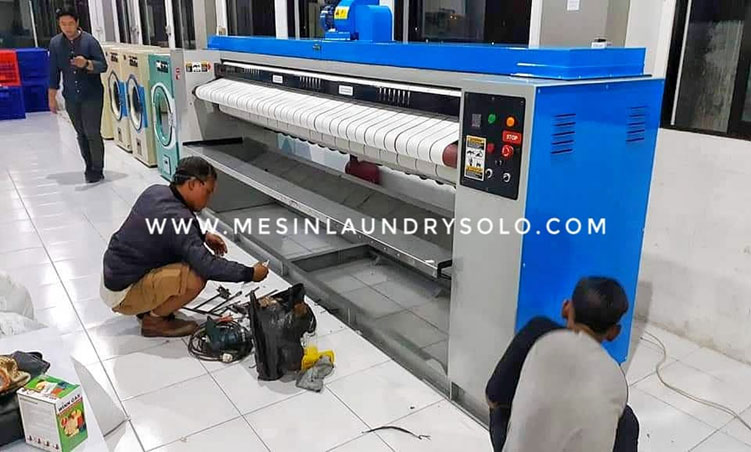 mesin flatwork roll ironer